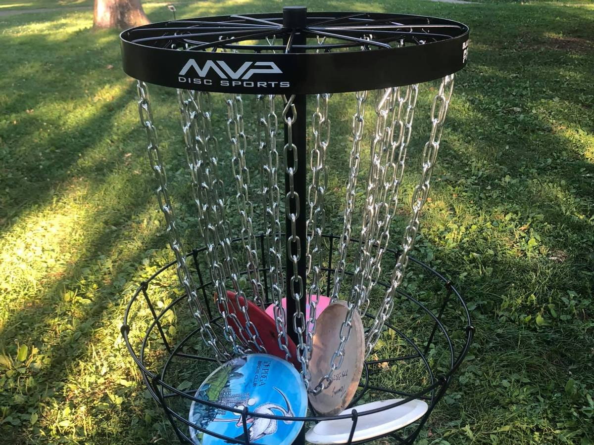 Disc Golf Basket with Discs in Nichols Park